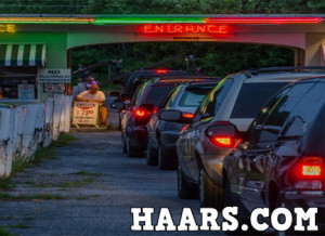 Line of cars waiting to get in at Haars Drive-In